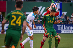 November 4, 2018 - Portland, OR, U.S. - PORTLAND, OR - NOVEMBER 04: Seattle Sounders goal keeper Stefan Frei anticipates a cross over Portland Timbers defender Bill Poni Tuiloma (25) during the Portland Timbers first leg of the MLS Western Conference Semifinals against the Seattle Sounders on November 04, 2018, at Providence Park in Portland, OR. (Photo by Diego Diaz/Icon Sportswire) (Credit Image: © Diego Diaz/Icon SMI via ZUMA Press)