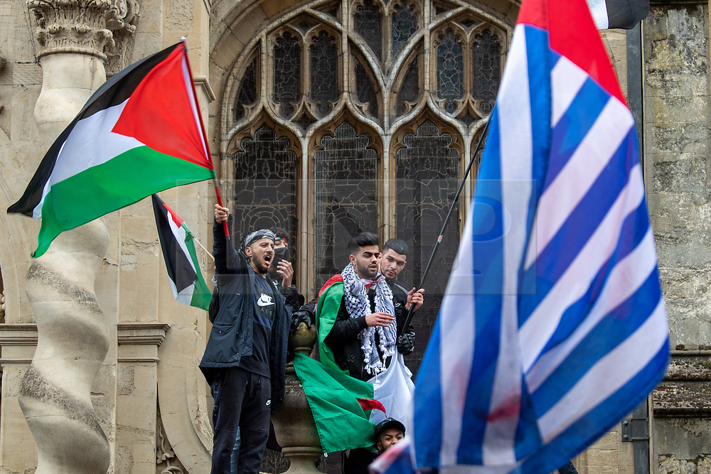 © Licensed to London News Pictures. 16/05/2021. Oxford, UK. Young men hold Palestinian flags at the 'Speak up for Palestine' demonstration held in Oxford, the crowd marched on the planned route from Manzil Way to Bonn Square in central Oxford. Photo credit: Peter Manning/LNP