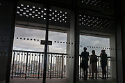 Three people look out over London on the viewing terrace at Tate Modern art gallery, on 13th January 2017 in London, England.