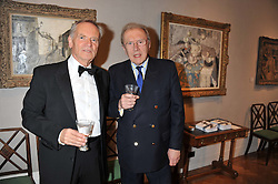 Left to right, LORD ARCHER and SIR DAVID FROST at a reception to unveil the Limited Centenary Edition of Sir George Frampton's statuette of Peter Pan in aid of the Moat Brae Charity held at The Fine Art Society, 148 New Bond Street, London on 1st May 2012.