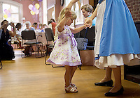 THOMASTON, CT- 19 JULY 2008- 071908JT05-.Meredith Valley, 3, of Bristol, dances with Belle, played by Dana Daunis, from Beauty and the Beast during a tea party hosted by Belle and her enchanted friends at the Thomaston Opera House on Saturday before the opening night of the play, which will run for four weeks. A second tea party will be held Aug. 2..Josalee Thrift / Republican-American