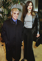 MR & MRS BERNIE ECCLESTONE he is the Formula One chief, at a party in London on 23rd February 1999.MOO 90