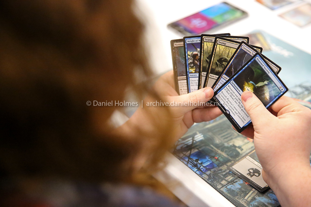 (12/28/18, FRANKLIN, MA) Orion Gammon, of Franklin, looks at his cards while playing the game Magic at Pete's Nerd Emporium in Franklin on Friday. [Daily News and Wicked Local Photo/Dan Holmes]