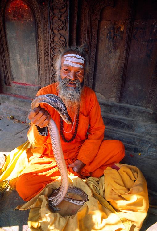 Sadhu with snake, Durbar Square, Patan, Kathmandu Valley, Nepal