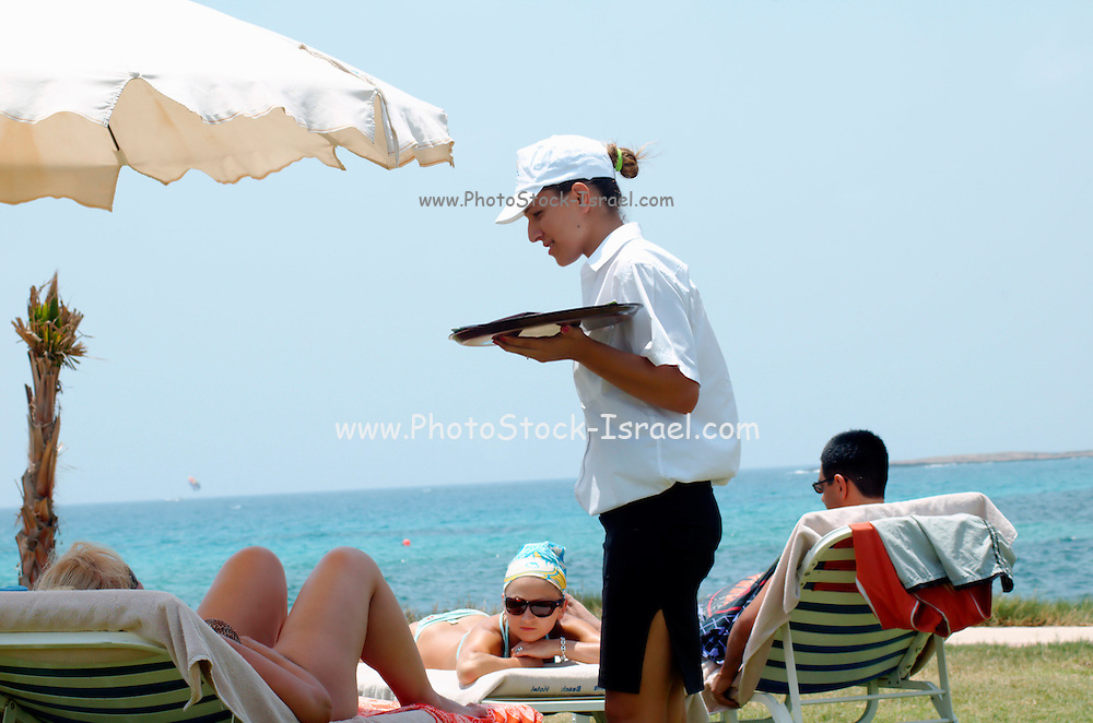 Cyprus, Agia Napa, a female waitress taking drink orders from hotel guests Agia Napa is a small vacation town on the Mediterranean Sea on the southern shores of the island