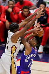 October 23, 2018 - New Orleans, LA, U.S. - NEW ORLEANS, LA - OCTOBER 23:  New Orleans Pelicans forward Solomon Hill (44) defends the basket against LA Clippers guard Shai Gilgeous-Alexander (2) on October 23, 2018, at Smoothie King Center in New Orleans, LA. (Photo by Stephen Lew/Icon Sportswire) (Credit Image: © Stephen Lew/Icon SMI via ZUMA Press)
