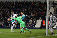 West Bromwich Albion goalkeeper Ben Foster saves from Jordi Amat of Swansea city. Premier league match, West Bromwich Albion v Swansea city at the Hawthorns stadium in West Bromwich, Midlands on Wednesday 14th December 2016. pic by Andrew Orchard, Andrew Orchard sports photography.