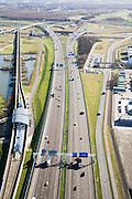 Nederland, Zuid-Holland, Pernis, 04-03-2008; autosnelweg A4 gezien naar het Zuiden, richting Knooppunt Benelux (of Beneluxplein); de A4 houdt bij het knooppunt op en gaat over in de A15 (naar links en naar rechts); in de toekomst zou de A4 doorgetrokken naar het Zuiden doorgetrokken moeten worden (richting Bergen op Zoom); links de metro (Callandlijn) met metrostation Pernis. .luchtfoto (toeslag); aerial photo (additional fee required); .foto Siebe Swart / photo Siebe Swart