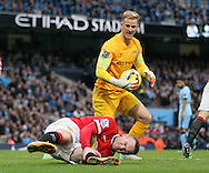 Joe Hart of Manchester City checks on the well being off Wayne Rooney of Manchester United - Barclays Premier League - Manchester City vs Manchester Utd - Etihad Stadium - Manchester - England - 2nd November 2014  - Picture David Klein/Sportimage