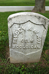 26 August 2017:   A part of the History of McLean County Illinois.<br /> <br /> Tombstones in Evergreen Memorial Cemetery.  Civic leaders, soldiers, and other prominent people are featured. Section 5, the old town soldiers area<br /> Reuben M. Wilcox  Co M  2 COLO CAV