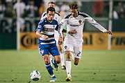 Los Angeles Galaxy midfielder David Beckham, right, challenges FC Dallas midfielder Bruno Guarda for the ball during the first half of an MLS soccer match, Wednesday, Aug. 6, 2011, in Carson, Calif. (AP Photo/Bret Hartman)