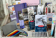 Display of various art materials for drawing sketching  in shop window, Marlborough, Wiltshire, England, UK