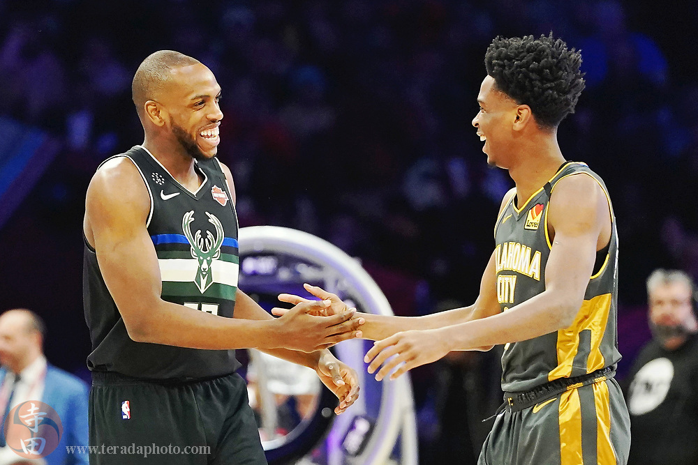Feb 15, 2020; Chicago, Illinois, USA; Milwaukee Bucks forward Khris Middleton (left) and Oklahoma City Thunder player Shai Gilgeous-Alexander high five during the skills challenge during the NBA All Star Saturday Night at United Center.