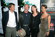 Director David Mackenzie (left) arrives with stars Peter Mullan, Emily Mortimer (centre) and Therese Bradley at the UGC cinema for the gala screening of their latest film 'Young Adam'. The screening marks the opening of the annual Edinburgh International Film Festival which runs until 24th August..