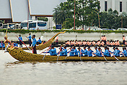 27 SEPTEMBER 2012 - BANGKOK, THAILAND: Boats in the Thai Royal Barge Procession flotilla are rowed down the Chao Phraya River in Bangkok. The Thai Royal Barge Procession is a ceremony of both religious and royal significance that goes back almost 700 years. The Royal Barge Procession takes place rarely, typically coinciding with only the most significant cultural and religious events. This year there will be a full procession on November 9 to mark the end of Buddhist Lent. There have been only 16 full processions during the 60 year reign of King Bhumibol Adulyadej. The barges are manned by 2,082 oarsmen. The Procession proceeds down the Chao Phraya River, from the Wasukri Royal Landing Place in Khet Dusit, Bangkok, passes the Temple of the Emerald Buddha, the Grand Palace, Wat Po and arrives at Wat Arun (the Temple of the Dawn).    PHOTO BY JACK KURTZ