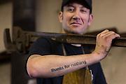Blacksmith Frank Verga holds a sledgehammer in an metal work shop in Charleston, SC