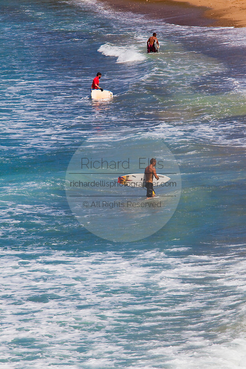 Surfers wait for waves at Playa Domes Rincon Puerto Rico