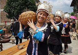 September 2, 2017 - People carry food as they prepare a dinner in the Singing Festival in Baozeng Village for the ethnic Dong group, Lejiang Town of Multinational Autonomous County of Longsheng in south China's Guangxi Zhuang Autonomous Region, Sept. 2, 2017. People tend to believe that the Dong ethnic group keeps its civilization passing on by singing the stories from generation to generation due to lack of written language. The festival featuring music play and daily labor competition is also an occasion to express their wish for a good harvest. (Credit Image: © Huang Yongdan/Xinhua via ZUMA Wire)