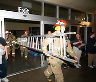 6/8/08 Omaha, NE Firefighters exit Walmart at 132nd and L streets where there was a partial roof collapse.  According to scanner reports and people  on the scene, the collapse was in the center and everyone was accounted for..(chris machian/Omaha World Herald)