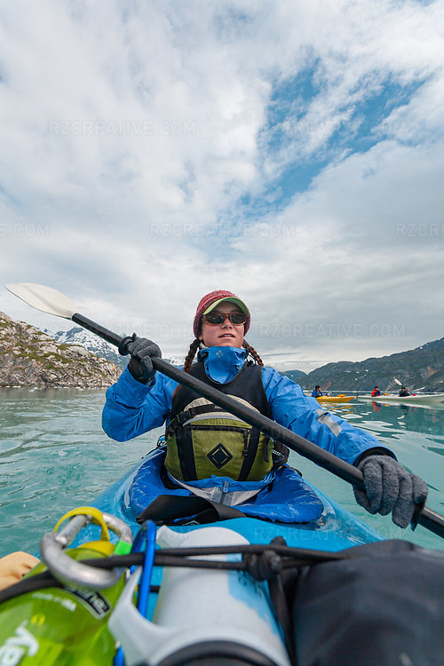 Paddler Kate Stepan paddles a kayak in Johns Hopkins Inlet in southeast Alaska's Glacier Bay National Park and Preserve. Photo © Robert Zaleski / rzcreative.com<br /> —<br /> To license this image contact: robert@rzcreative.com