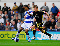 Photo: Leigh Quinnell.<br /> Queens Park Rangers v Cardiff City. Coca Cola Championship. 18/08/2007. QPRs Michael Mancienne holds the ball from Cardiffs Paul Parry.