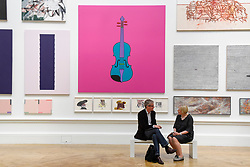 "© Licensed to London News Pictures. 08/06/2017. London, UK. Visitors sit in front of (C) ""Untitled (Violin)"" by Sir Michael Craig-Martin RA (GBP120,000).  Preview of the Summer Exhibition 2017 at the Royal Academy of Arts in Piccadilly.  Co-ordinated by Royal Academician Eileen Cooper, the 249th Summer Exhibition is the world's largest open submission exhibition with around 1,100 works on display by high profile and up and coming artists.<br />  Photo credit : Stephen Chung/LNP"