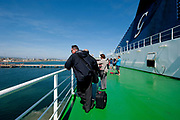 Passengers are seen on the Grimaldi Lines Cruise Barcelona,  arriving to Porto Torres in Sardinia, Italy, on Tuesday, June 11, 2013.  Photographer: Víctor Sokolowicz/Bloomberg.