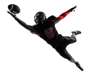 one american football player catching ball in silhouette shadow on white background