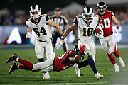Los Angeles Rams wide receiver and punt returner Pharoh Cooper (10) is tackled by diving Atlanta Falcons running back Terron Ward (28) as he returns a second quarter punt 14 yards to the Rams 40 yard line during the 2018 NFC Wild Card NFL playoff football game against the Atlanta Falcons, Saturday, Jan. 6, 2018 in Los Angeles. The Falcons won the game 26-13. (©Paul Anthony Spinelli)