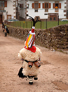 """A child dressed of """"Joaldun"""" marchs carrying sheep furs and cowbells on his back on January 30th, 2006 at the village of Ituren, Basque Country. Joaldun groups perform an ancient traditional carnival at the villages of Ituren and Zubieta making sound their cowbells in order to wake up the earth, to ask for a good new year, a good harvest and also to keep away the bad spirits. (Ander Gillenea / Bostok Photo)"""