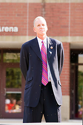 19 September 2009: Doug Collins stands surrounded by a swarm of gnats awaiting his chance to make a statement. Illinois State University took the day to celebrate 2 of it's own, the late Will Robinson and national hero Doug Collins.  Will Robinson became the first black head basketball coach in NCAA Division I history when names ISU basketball coach in 1970.  Doug Collins was an Illinois State standout basketball player who represented the United States in the 1972 Olympics, played NBA ball for several years where he later coached and recently recieved the Curt Gowdy Media Award for career in broadcasting.  A statue was erected in their honor on the terrace just north of the main entrance to Redbird Arena on ISU's campus in Normal IL