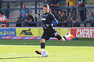 AFC Wimbledon goalkeeper Joe McDonnell (24) warming up during the EFL Sky Bet League 1 match between AFC Wimbledon and Portsmouth at the Cherry Red Records Stadium, Kingston, England on 13 October 2018.