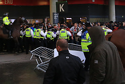 14 September 2017 -  UEFA Europa League (Group H) - Arsenal v FC Koln - Police officers react with batons as the FC Koln fans appear to storm the away entrance at Emirates Stadium  - Photo: Offside