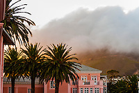 Fog sweeping in with a gale force wind over Table Mountain, seen from the Belmond Mount Nelson Hotel, Cape Town, South Africa.