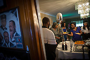 Jeena Bradley (in blue) prepares a plate of food to bring up to her daughter Nailah Bradley who was getting dressed Saturday, May 17, 2014 while friends and family arrived for her prom send-off party at her South Shore home. (Brian Cassella/Chicago Tribune) B583716572Z.1  ....OUTSIDE TRIBUNE CO.- NO MAGS,  NO SALES, NO INTERNET, NO TV, CHICAGO OUT, NO DIGITAL MANIPULATION...