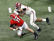 ATLANTA, GA - JANUARY 08:  Quarterback Jake Fromm #11 of the Georgia Bulldogs is tackled by defensive end Raekwon Davis #99 of the Alabama Crimson Tide during the College Football Playoff National Championship game at Mercedes-Benz Stadium on January 8, 2018 in Atlanta, Georgia.  (Photo by Mike Zarrilli/Getty Images)