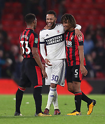 Middlesbrough's Lewis Baker speaks with AFC Bournemouth's Nathan Ake (right) and Jordon Ibe after the Carabao Cup, Fourth Round match at the Vitality Stadium, Bournemouth.