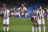 Saido Berahino of West Bromwich Albion © jumps as he warms up before k/o. Barclays Premier League match, Crystal Palace v West Bromwich Albion at Selhurst Park in London on Saturday 3rd October 2015.<br /> pic by John Patrick Fletcher, Andrew Orchard sports photography.
