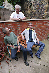 Residents chatting over the garden wall at Supported housing project,