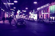 Hotel Ambassador and shops on Kartnerstrasse , Vienna, Austria at night  early 1960s