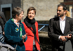 © Licensed to London News Pictures. 12/05/2014; Bristol, UK.  Ska Keller (red jacket), German Green MEP and Presidential candidate for the EU Commission, on a visit to Bristol to meet Green Party members campaigning in the European elections.  Pictured here with Molly Scott Cato (left), Green MEP candidate for south west England.<br /> Photo credit: Simon Chapman/LNP