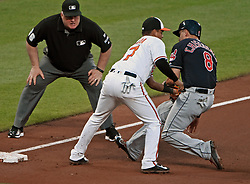 June 20, 2017 - Baltimore, MD, USA - The Baltimore Orioles Ruben Tejada, middle, tags out the Cleveland Indians' Lonnie Chisenhall, right, on the back end of a double play in the fourth inning at Oriole Park at Camden Yards in Baltimore on Tuesday, June 20, 2017. The Orioles won, 6-5. (Credit Image: © Kenneth K. Lam/TNS via ZUMA Wire)