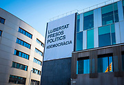 """New banner on the ajuntament - town hall of Sant Cugat del Valles, Barcelona, Catalonia, calling for """"llibertat presos politics"""" - free political prisoners, after the jailing by the Spanish government of Catalan government ministers and civil society leaders after the declaration of the Republic of Catalonia. The original banner was torn down and destroyed by extreme right wing protestors on November 6th, 2017."""