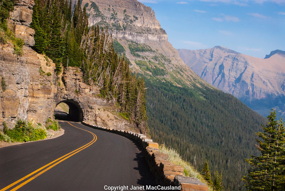 """The views on """"Going to the Sun Road"""" in Glacier National Park are breathtaking. It is a narrow road on the edge of steep cliffs and it passes through tunnels bored into the mountains' rock face. The road is impassable most of the year due to snow and falling rocks."""