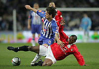 """PORTUGAL - PORTO 28 FEBRUARY 2005: DIEGO Ribas da Cunha #16 and CARLOS GARCIA """"CARLITOS"""" #7 compete for the ball, in the 23 leg of the Portuguese soccer league """"Super Liga"""" FC Porto (1) vs SL Benfica (1), held in """"Dragao"""" stadium  28/02/2005  21:05:25<br />(PHOTO BY: NUNO ALEGRIA/AFCD)<br /><br />PORTUGAL OUT, PARTNER COUNTRY ONLY, ARCHIVE OUT, EDITORIAL USE ONLY, CREDIT LINE IS MANDATORY AFCD-PHOTO AGENCY 2004 © ALL RIGHTS RESERVED"""