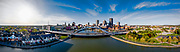 Panoramic view of the City of Rochester, New York with the Frederick Douglass–Susan B. Anthony Memorial Bridge in the foreground. The bridge is an arch-supported roadway crossing the Genesee River, encompassing 140.9 metres (462.3 ft). Photo by Alan Schwartz.
