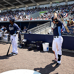 March 20, 2011; Port Charlotte, FL, USA; Tampa Bay Rays left fielder Manny Ramirez (left) and third baseman Evan Longoria (right) prepare to bat during a spring training exhibition game against the Baltimore Orioles at Charlotte Sports Park.  Mandatory Credit: Derick E. Hingle-US PRESSWIRE