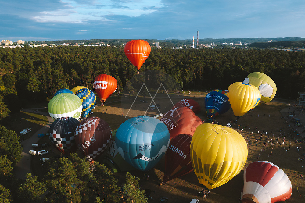 Vilnius, Lithuania - 3 July 2021: Aerial view of hot air balloons taking off from Vingis park and flying over Vilnius in summer time, Lithuania.