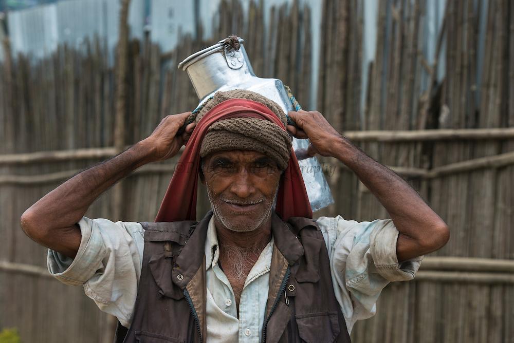 Ao Naga Man carrying water container<br /> Ao Naga Headhunting Tribe<br /> Mokokchung district<br /> Nagaland,  ne India