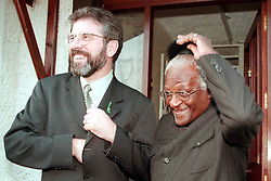 Sinn Fein leader Gerry Adams and Archbishop Desmond Tutu at Connoly House in West Belfast, this evening (Thursday). Picture by Brian Little/PA. See PA story ULSTER Tutu.